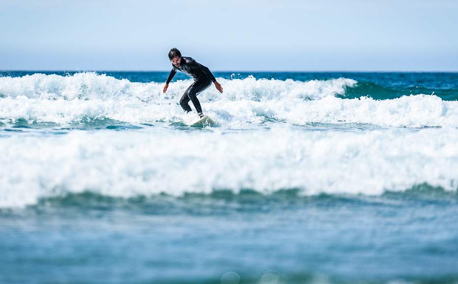 bigstock-Surfer-Guy-Surfing-With-Surfbo-307156066