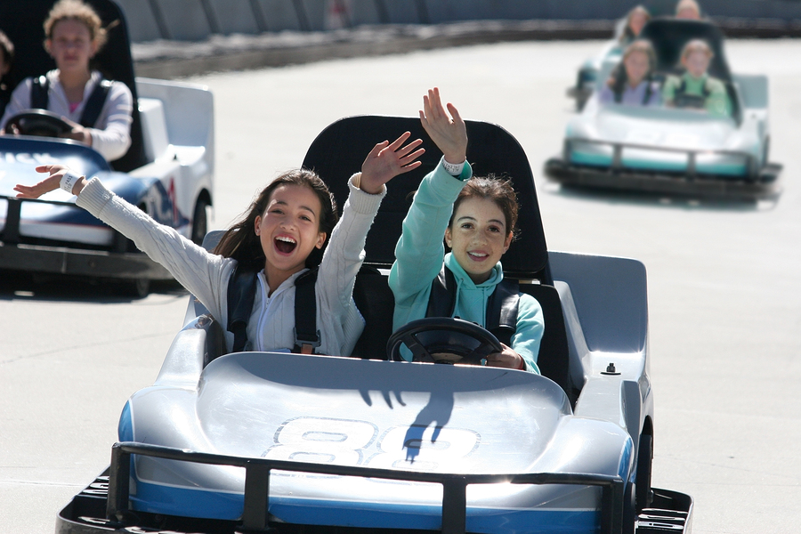bigstock-Two-Happy-Girls-On-Go-Cart-212771